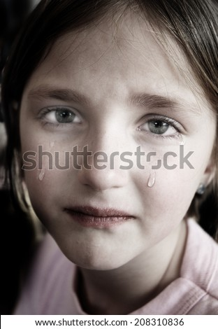 Little girl crying with tears rolling down cheeks on her face - stock photo