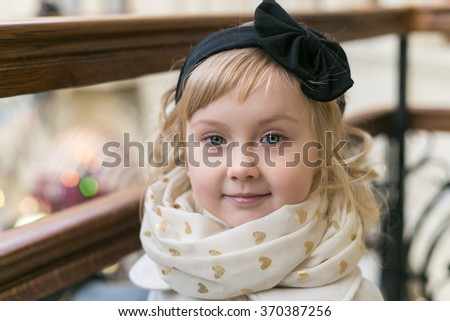 Little girl curly blond 4 years old with blue eyes - stock photo