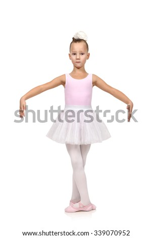 little girl dances ballet in her ballerina tutu, isolated on white
