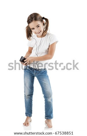 Little girl dancing while listen music with a MP3 player, isolated on white - stock photo