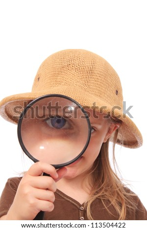 Little girl discovering new things - stock photo
