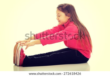 Little girl doing gymnastics exercise - stock photo