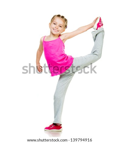 Little girl doing gymnastics over white background - stock photo