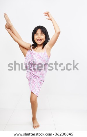 Little girl doing stretching before her ballet class