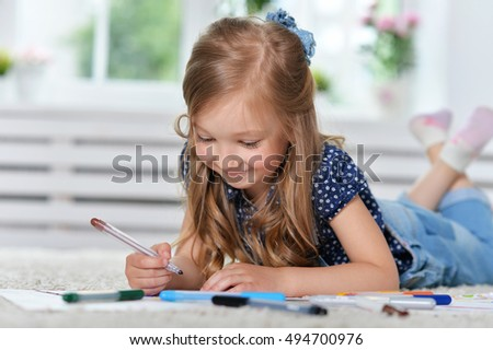 Little girl drawing at  class