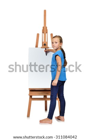 little girl drawing on a blank easel - stock photo