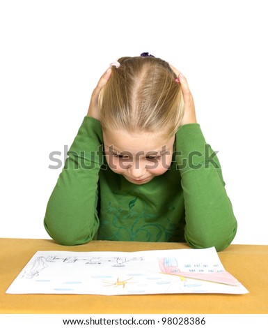 Little girl drawing on a white table. - stock photo