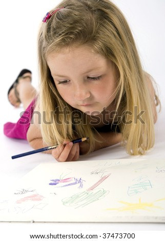 Little girl drawing on paper