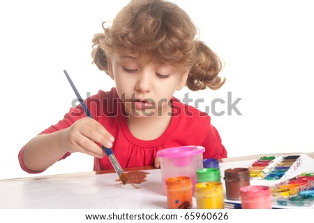Little girl draws a colored paint - stock photo