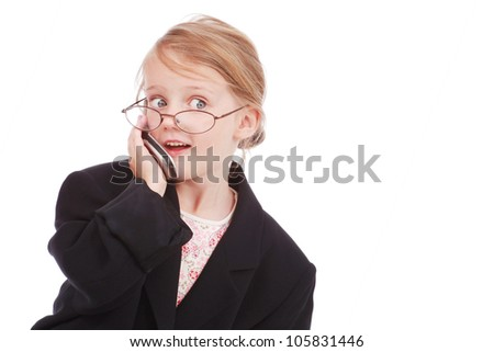 Little girl dressed as a businesswoman talking on a cell phone - stock photo