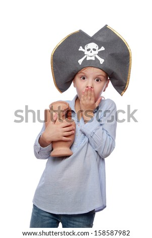 Little girl dressed as pirate for Halloween - stock photo