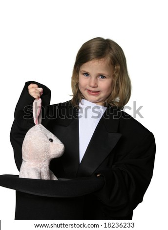 Little girl dressed in an over-sized magician costume pulling a rabbit out of a hat - stock photo