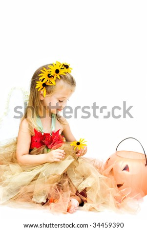 Little girl dressed up as a woodland fairy is ready for Halloween against white background.