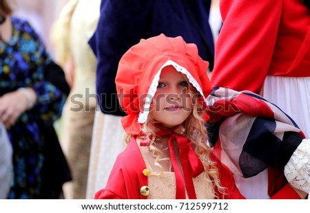 Little girl dressed up red bonnet at the Regency Costumed Promenade, the 200th anniversary of Jane Austenâs death in Bath,Royal Crescent,England,United Kingdom. 09/09/2017
