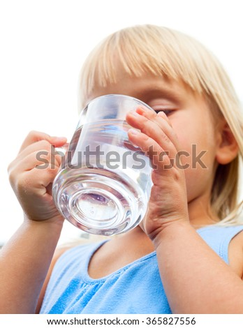 Little girl drinking water on white background - stock photo