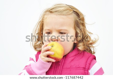 little girl eat apple