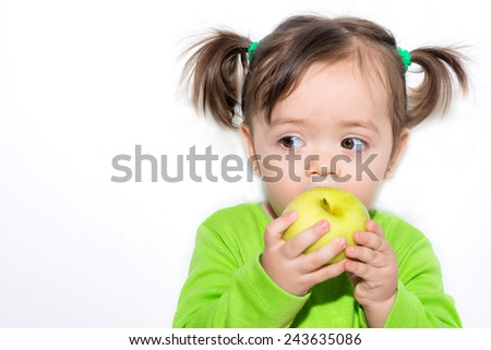 Little girl eating an apple - stock photo
