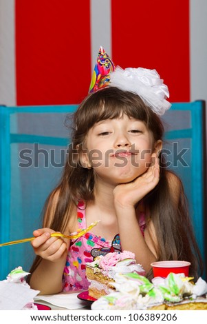 Little girl eating birthday cake - stock photo