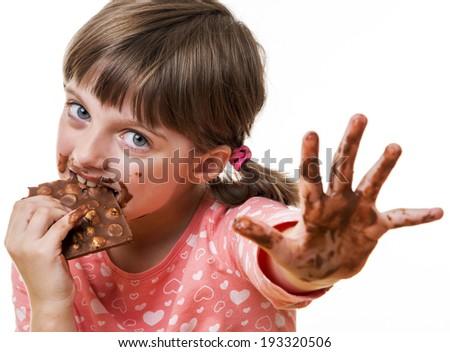 little girl eating chocolate - stock photo