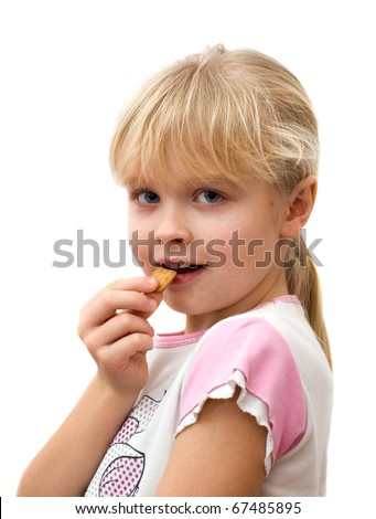 little girl eating cookies, white background - stock photo