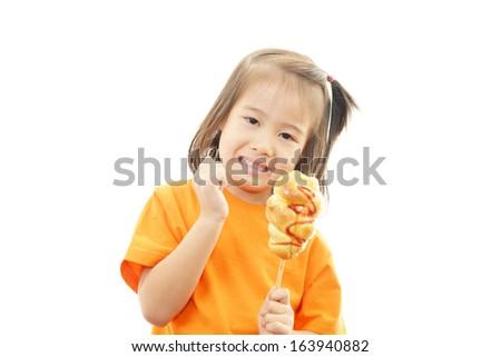 Little girl eating food - stock photo