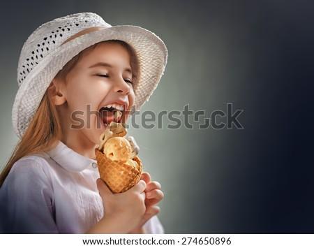 little girl eating ice cream - stock photo