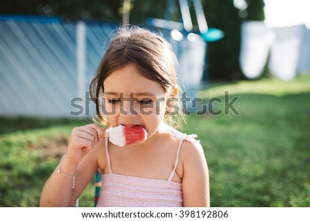 Little Girl Eating Ice-Cream
