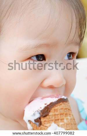 Little girl eating ice cream - stock photo