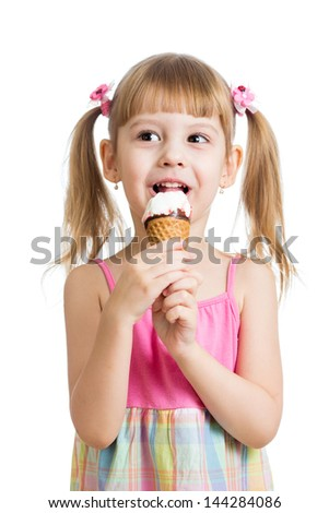 little girl eating ice cream in studio isolated - stock photo