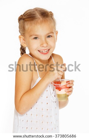 Little girl eating jello - stock photo