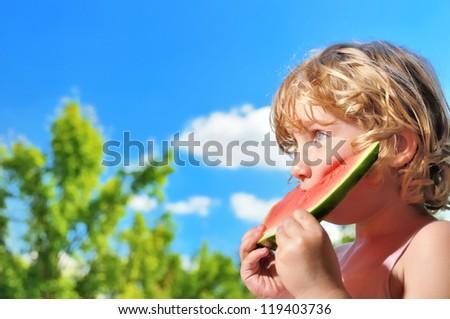 Little girl eating watermelon. - stock photo
