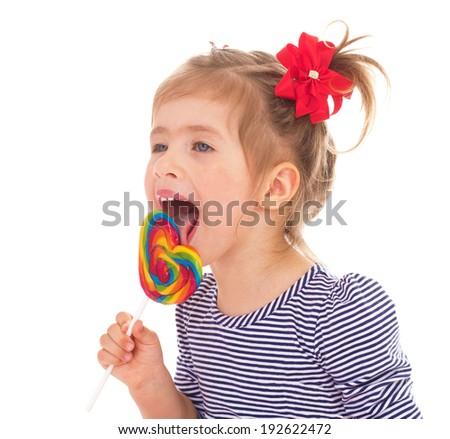 Little girl eats a big Lollipop - stock photo