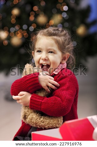 Little girl excited of the present she have got , it was the same like she wanted  to be ! - stock photo