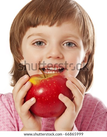 little girl four years old with red apple