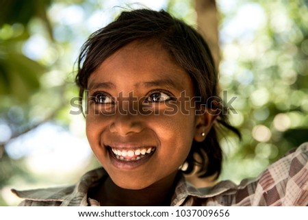 Little girl from a small village smiling in India