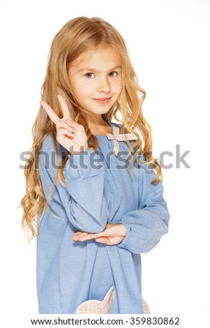 Little Girl Gives a Peace Sign - stock photo
