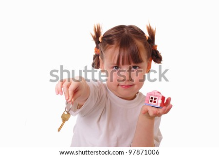 Little girl gives the key - stock photo