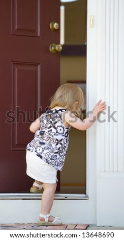 Little Girl Going into Home - stock photo