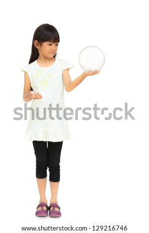 Little girl Hand holding a Glass Ball, Isolated over white - stock photo