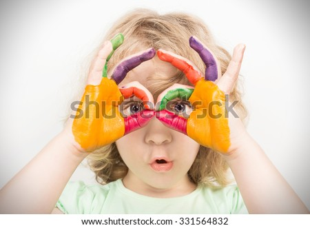 Little girl hands painted in colorful paints - stock photo