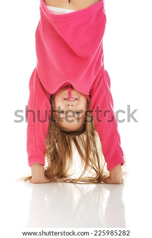 Little girl hanging upside down