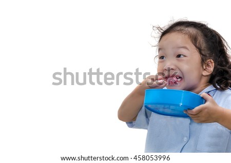 little girl happy eating