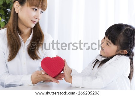 little girl has a gift box in her hand - stock photo