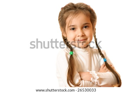 Little girl has crossed hands and smiles, is isolated on white background. - stock photo