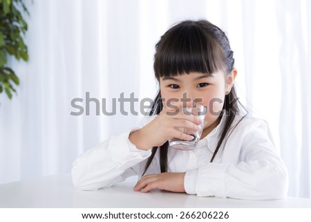 little girl have a drink of water - stock photo