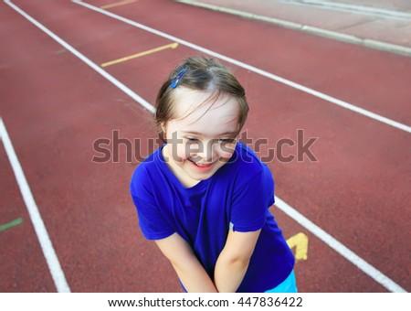 Little girl have fun on the stadium - stock photo