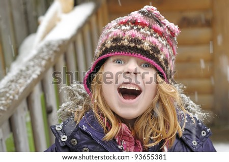 Little girl having a great time in the snow. - stock photo