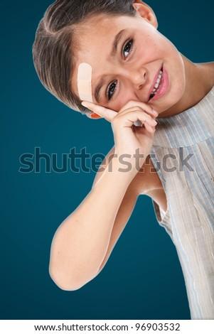 little girl having an injury on her head - stock photo