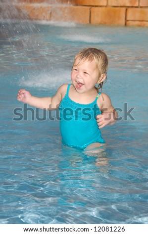 Little Girl Having Fun in Pool - stock photo