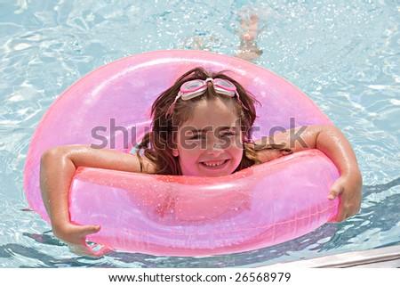 Little Girl Having Fun Swimming in the Pool - stock photo